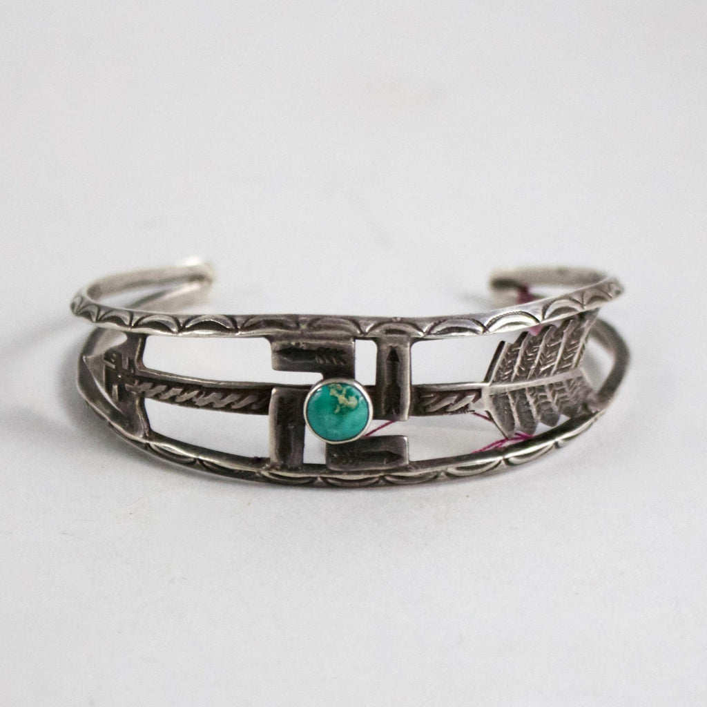 "This ""Whirling Log"" silver bracelet is a collector's piece. Vibrant turquoise stone in its center."