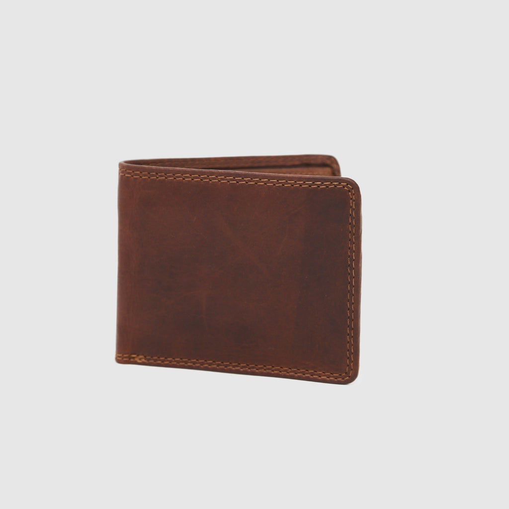 A Rugged Earth bi-fold wallet made with vegetable tanned leather.