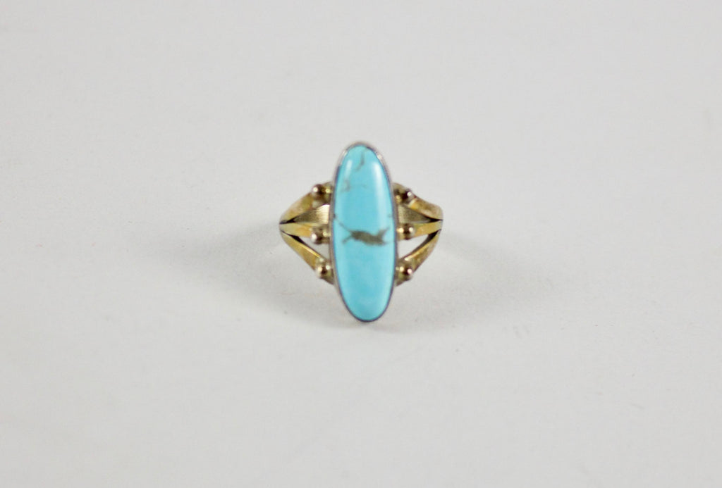 This beautiful ring features a stunning oval turquoise stone in its center. Sterling and stamped with a zuni bear in the band.