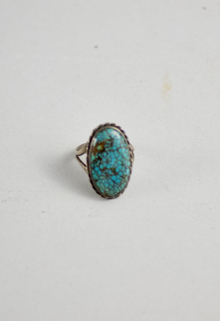 This beautiful turquoise ring is an estate piece and is estimated to be from the 1940's.