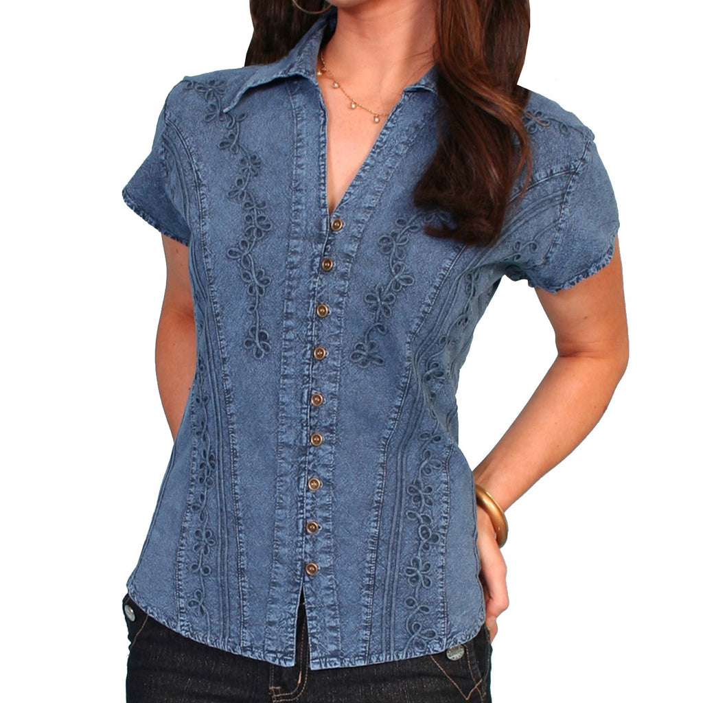 This blouse is made by Scully and features delicate floral designs along the blue fabric.