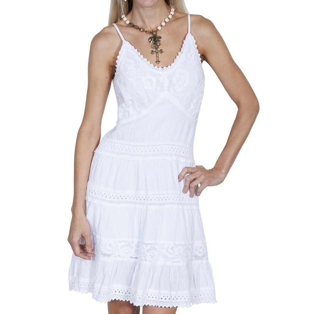 100% peruvian cotton short dress with spaghetti straps. It features a crochet overlay on the bodice with crochet edging, tiered panels with crochet edging and lace panel. Made by Scully.