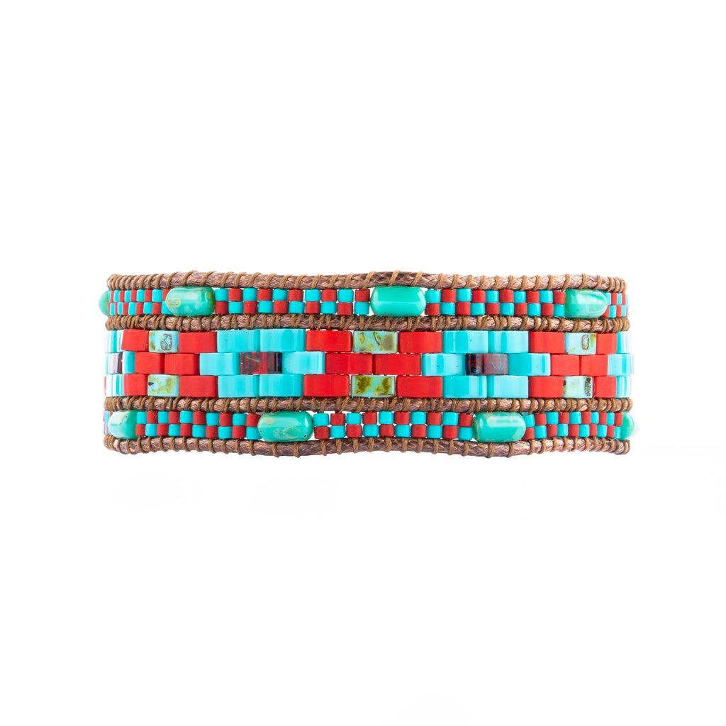 The Petula wrap is a red and turquoise beaded bracelet that is handcrafted.