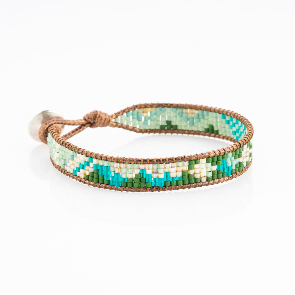 The Rikki green and turquoise beaded bracelet is perfect for festivals and country concerts with its western boho chic style.