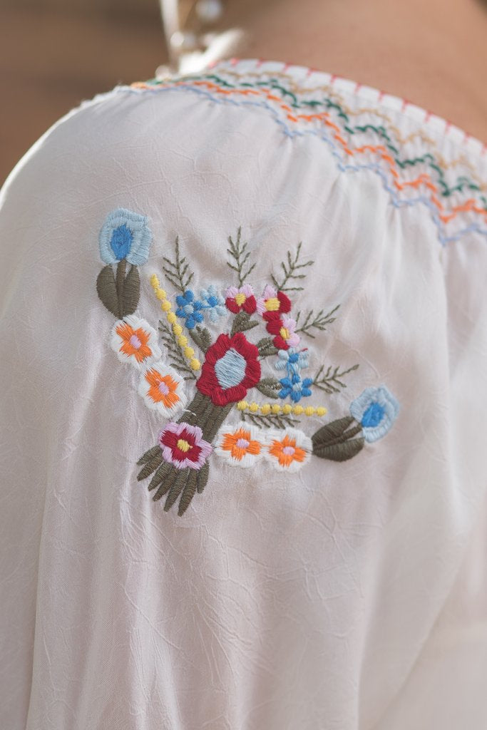 This Ryan Michael western embroidered top is a summertime classic! Made with silky cupra rayon fabric. V2040CR