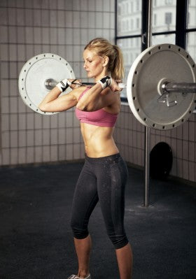 Woman Performing a Barbell Complex