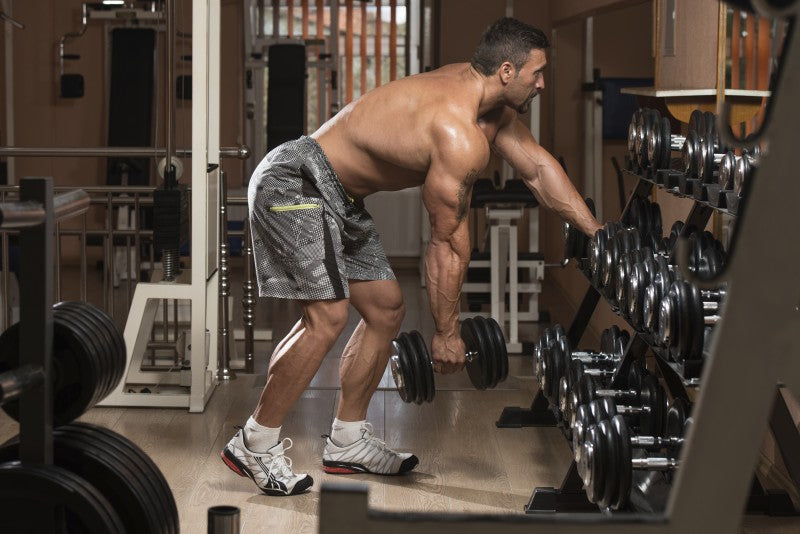 Bodybuilder performing Dumbbell Rows