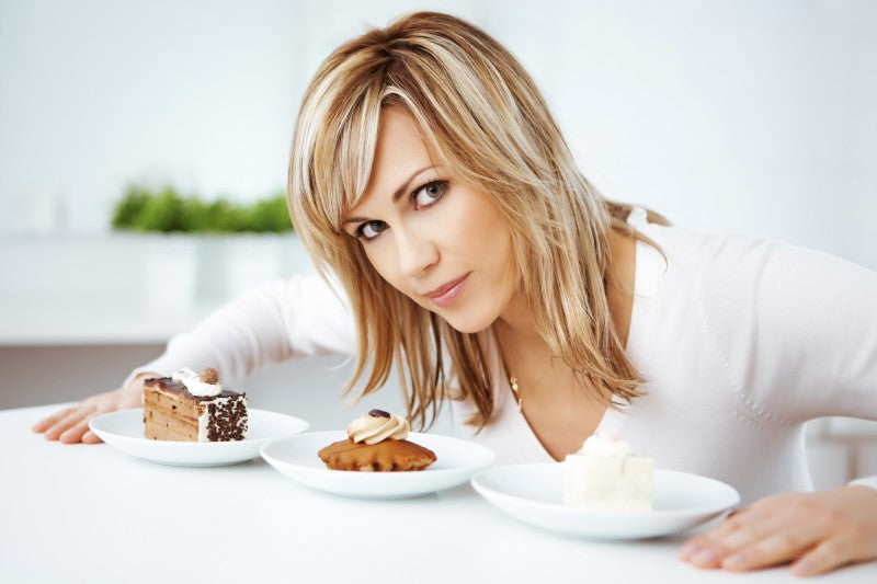 Woman Eating Desserts