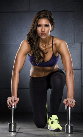 Fit Woman Leaning on Dumbbells