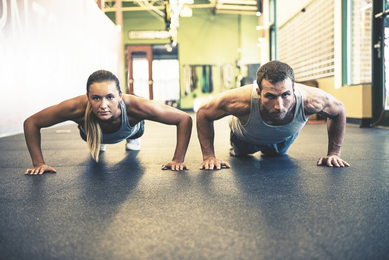 Couple Performing Push Ups