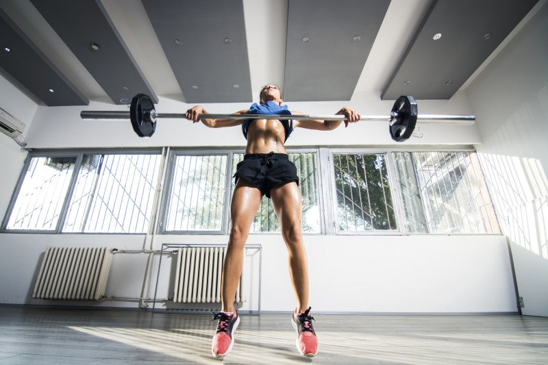 Woman Performing Power Cleans