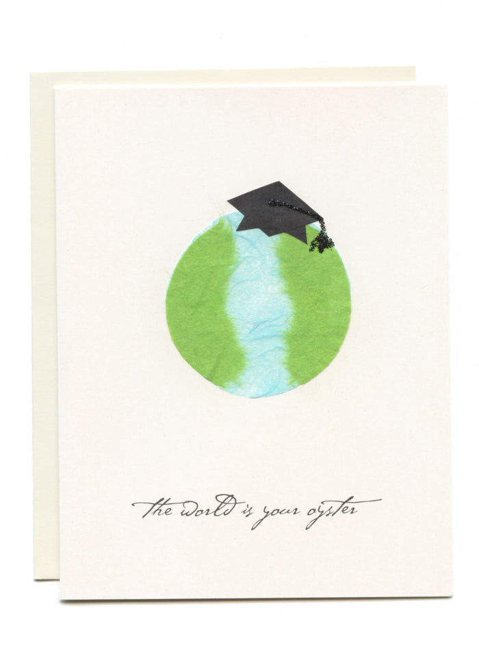 """The World is Your Oyster""  Grad Cap on Globe"