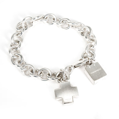 Tiffany & Co. Shopping Bag & Cross Charm Bracelet in  Sterling Silver