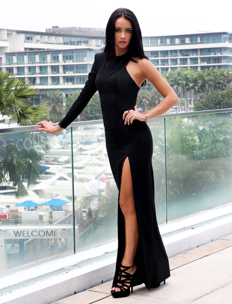 model in black cut out evening dress at Singapore yacht show