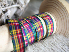 Thin bright tartan ribbon.