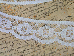 White lace ribbon. Available at Elliemagpie.
