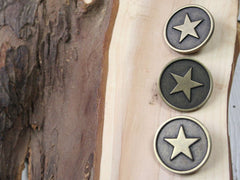 Antique bronze star buttons. Available from Elliemagpie.