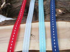 Saddlestitch ribbon - Available in 4 colours.