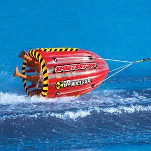 Gyro - spinning 1 rider inflatable tube barrel rolls across the water