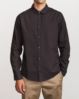 Man wearing black button up shirt