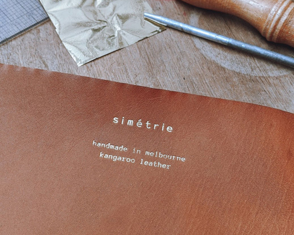 simétrie logo & handmade in melbourne text on kangaroo leather