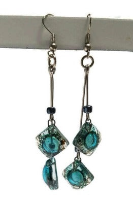 Long multiple bead brown and blue teal earrings. Bubbles