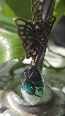 Green White and Black Leaf shape Reecycled Fused Glass pendant Necklace with a Butterfly Bail.