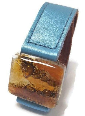 Leather cuff. Recycled Fused Glass earthy colors Bead and metallic baby blue Leather Bracelet