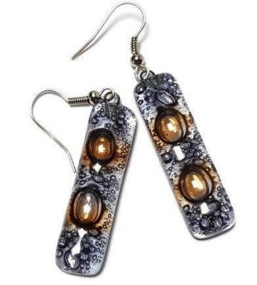 Clear lilac and Brown bars... Lots of  bubbles. Recycled Fused Glass Dangling earrings