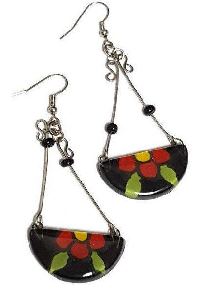 Long colorful handmade recycled fused glass earrings. Black with a red flower!