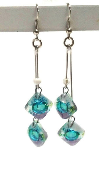 Long multiple bead white, green and purple earrings. Bubbles
