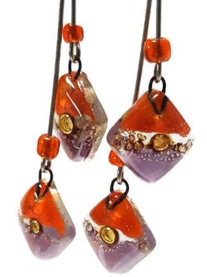 Long multiple bead brown, orange and purple earrings. Bubbles