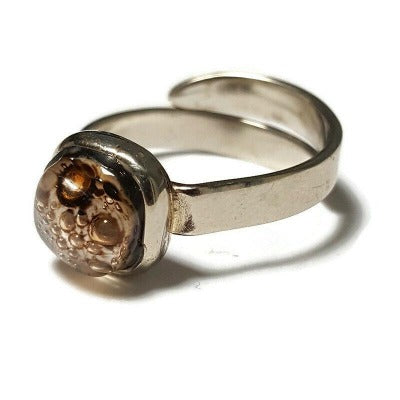 Small handmade ring. White and Brown Recycled glass handcrafted glass bead. Alpaca silver adjustable ring. Upcycled earth colors