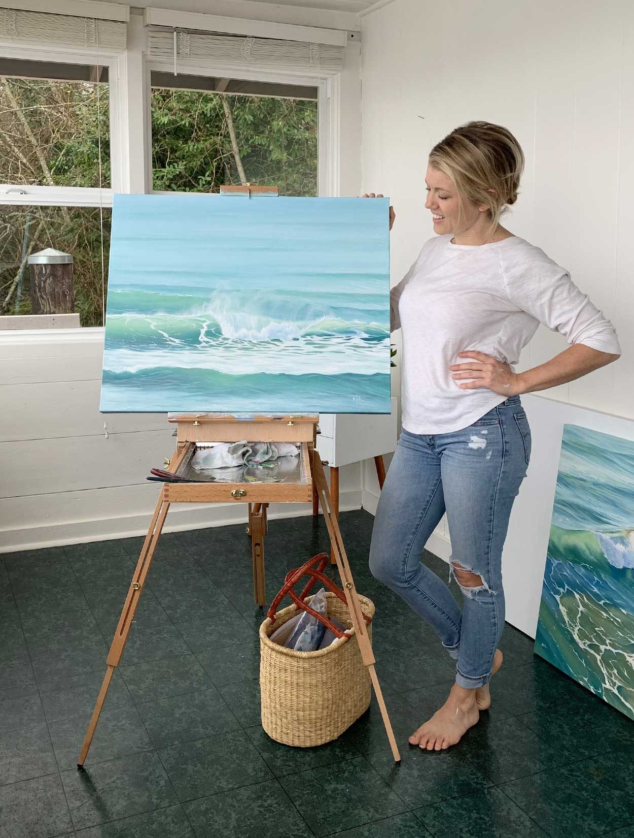 Artist Julie Kluh with Oil Painting Ocean Air in her Studio