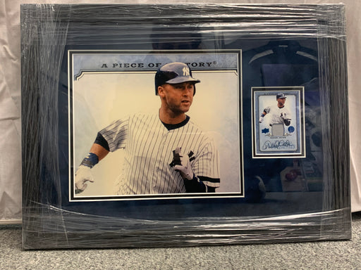 Derek Jeter photograph with autographed card