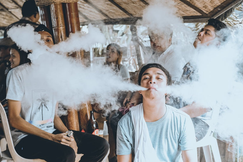 male vaping around friends