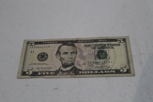 dollar bill with star after serial number