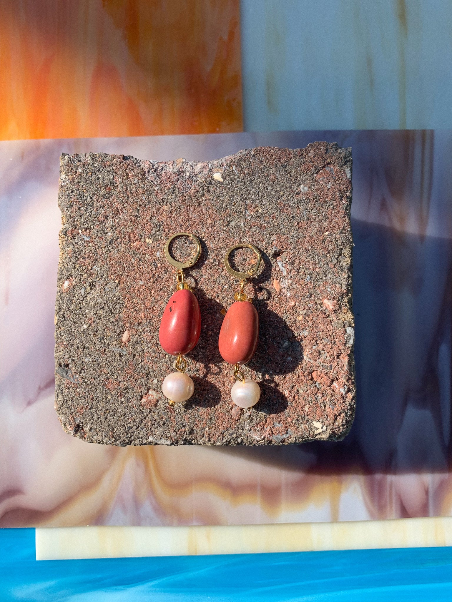 handmade earrings feature salmon colored vísola seeds