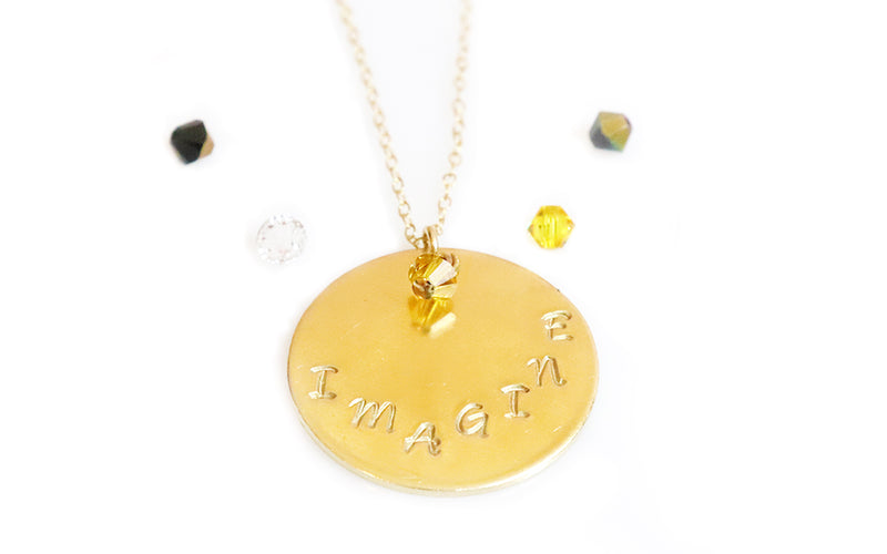 handstamped necklace charm with phrase in goldfilled