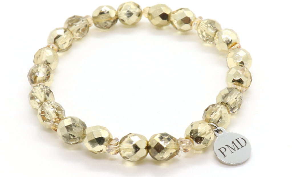 metallic pale gold beaded bracelet with silver logo charm for women