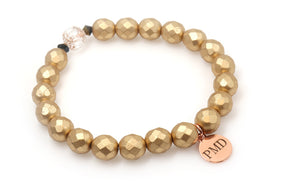 Satin gold beaded bracelet with rose gold charm for women