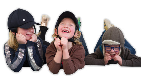 Happy children wearing Ribcap soft protective helmets