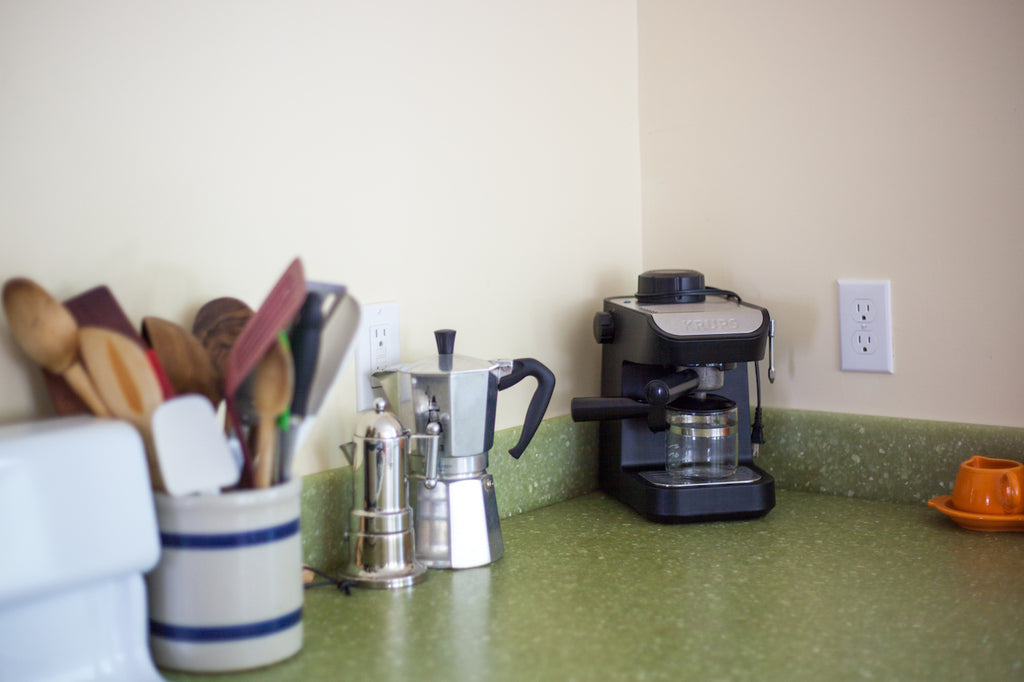 kitchen green countertops coffee maker