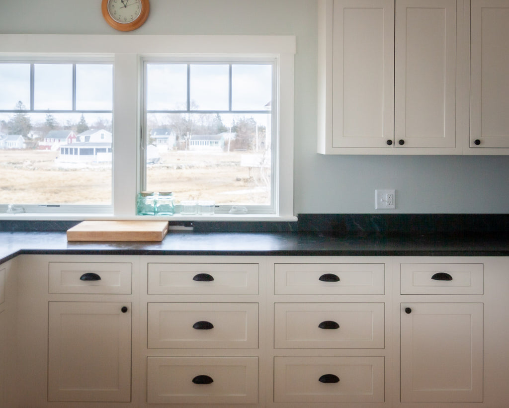 Inset cabinetry with knobs and pulls