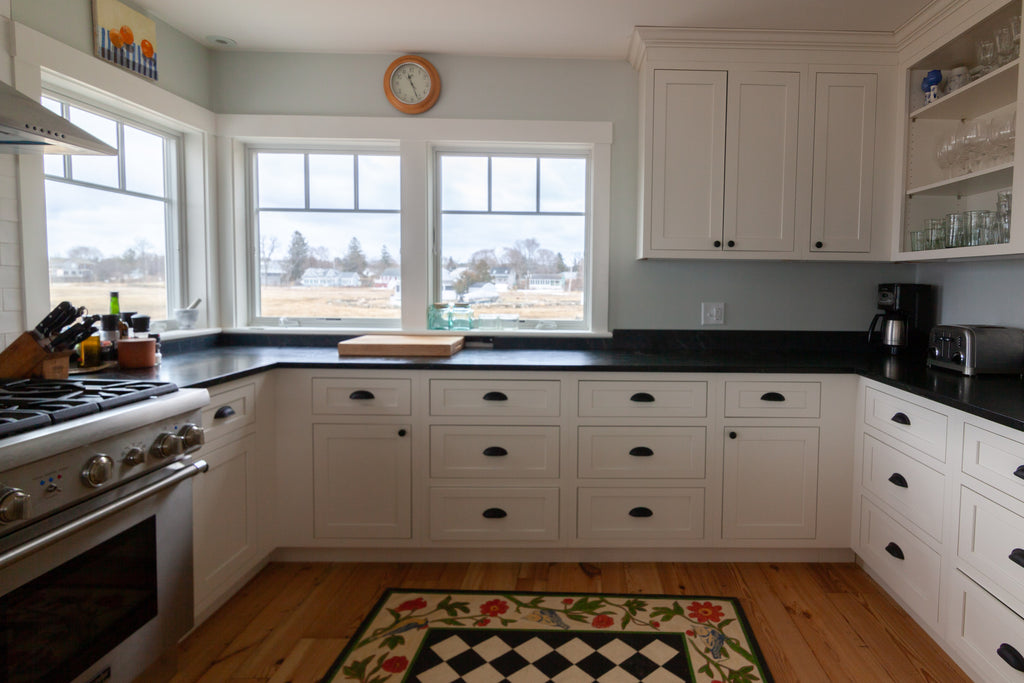 white kitchen inset cabinetry by design craft shaker style doors with black hardware