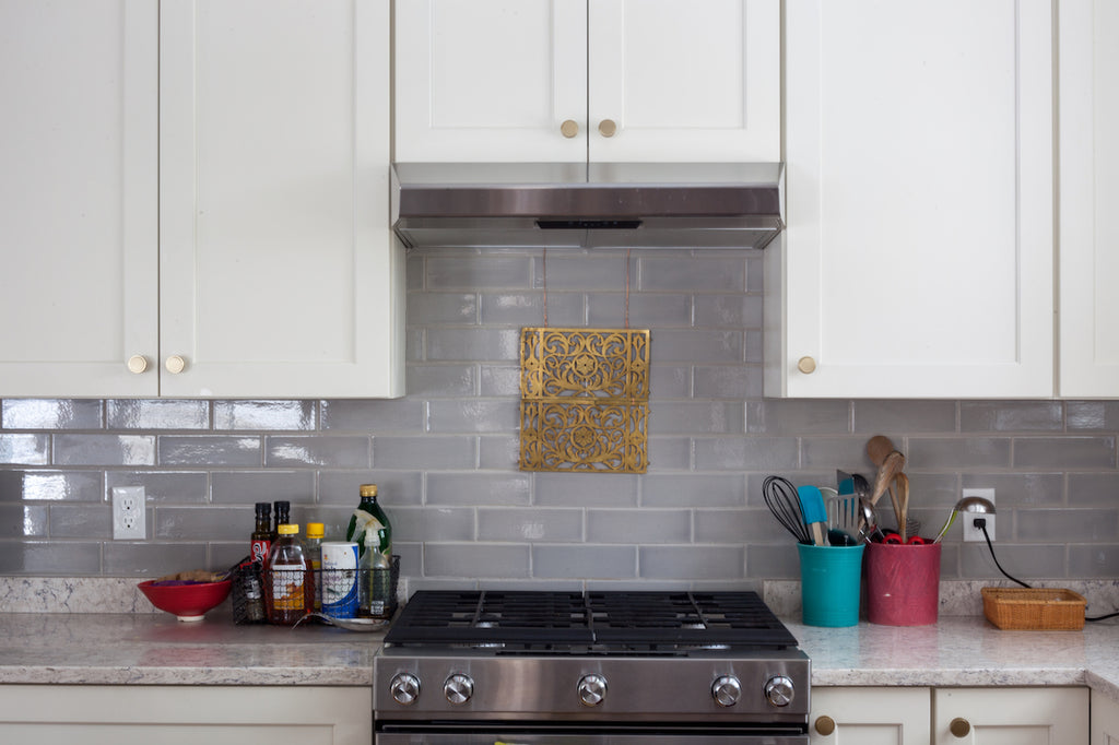 medallion cabinetry kitchen stove gray subway tile