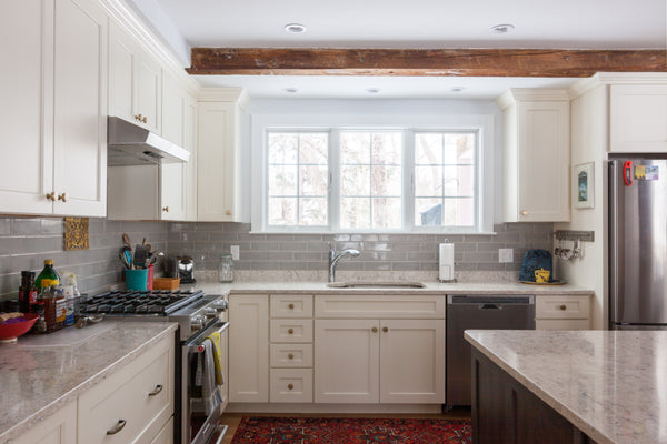 white kitchen cabinetry exposed beam island