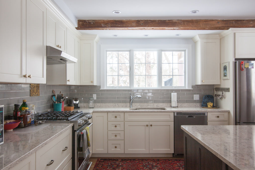 medallion cabinetry kitchen sink island exposed beams