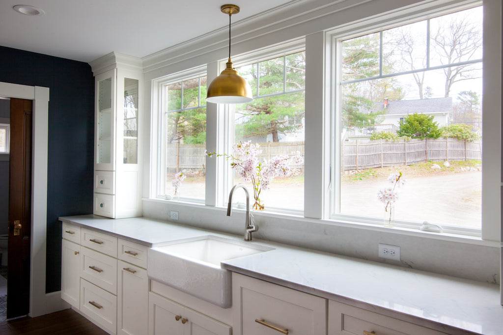 kitchen farmhouse sink windows medallion cabinetry