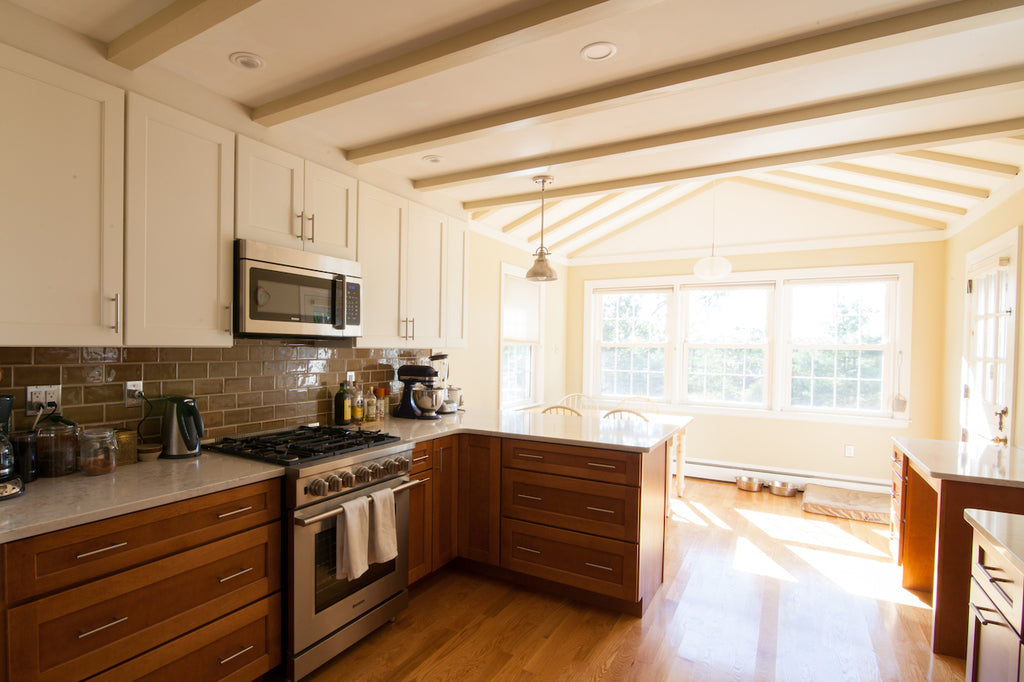 kitchen peninsula vaulted ceilings medallion cabinetry